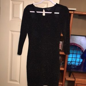 Fitted sparkly black mini dress
